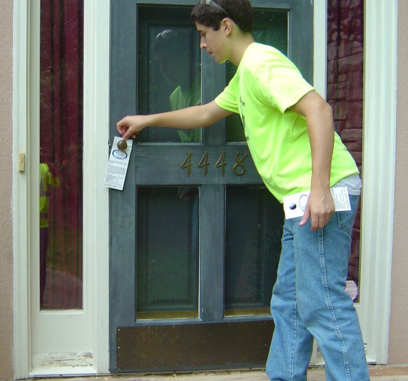 Boy Placing Flyer on Door